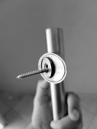 Cropped hand holding tool