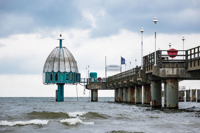 Pier on the Baltic Sea coast in Zinnowitz, Germany. Architecture Baltic Sea Beach Building Exterior Built Structure Cloud - Sky Day Holiday Horizon Over Water Jetty Journey Landmark Landscape Nature No People Outdoors Pier Sea Sky Tourism Travel Destinations Usedom, Germany Vacation Water Zinnowitz