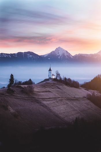 St Primoz Slovenia Church Sky Mountain Beauty In Nature Scenics - Nature Mountain Range Men Nature Real People Standing Water Tranquil Scene Tranquility Landscape Two People Outdoors Lifestyles Land Cloud - Sky People