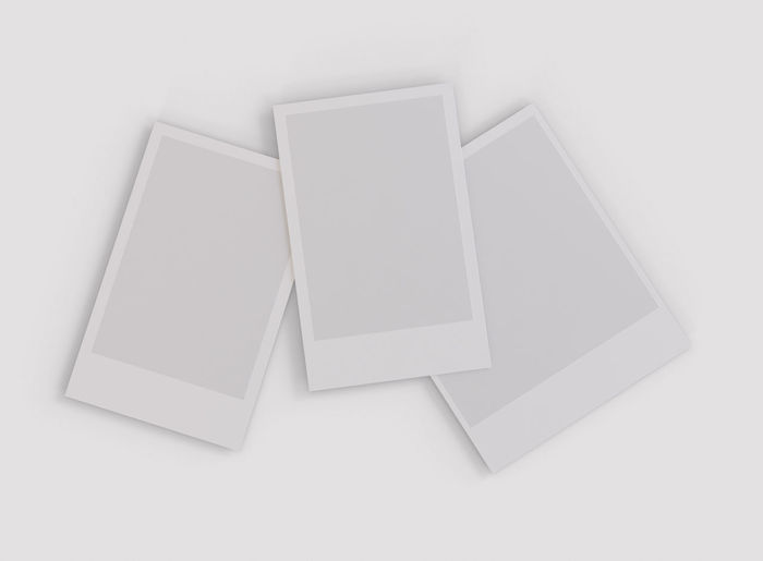 High angle view of papers over white background