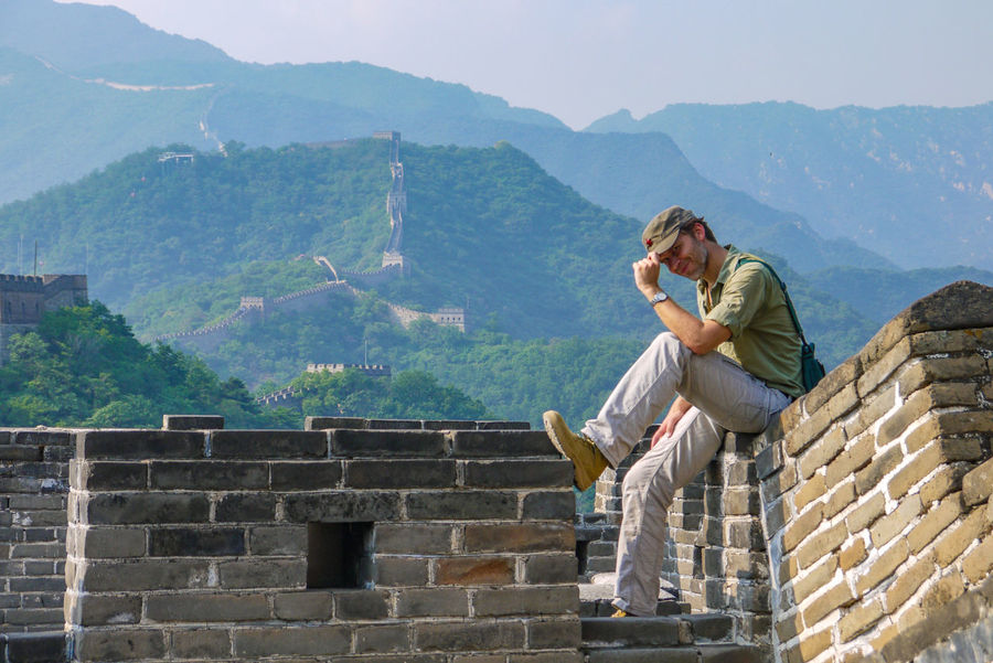 On the wall. The great wall of China is vast. Some parts have fallen into disrepair, but other parts are open for visitors. No visit to China can be complete without having seen this amazing construction. Adult Adventure ASIA China Photos Chinese Wall Countryside Full Length Great Wall Of China Journey Landscape Mountain Mountain Range One Man Only One Person Only Men Outdoors People Self Portrait Sky Steps Travel Travel Destinations Second Acts