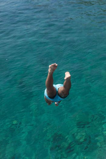Low section of man diving into sea