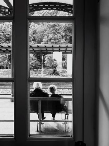 Window Real People Togetherness Day Looking Through Window Two People Leisure Activity Rear View Sitting Iphn Photography Iphonephotography IPhone 7 Plus Monochrome Photography