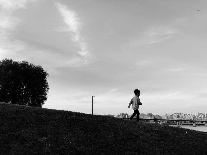 Boy Running River Park