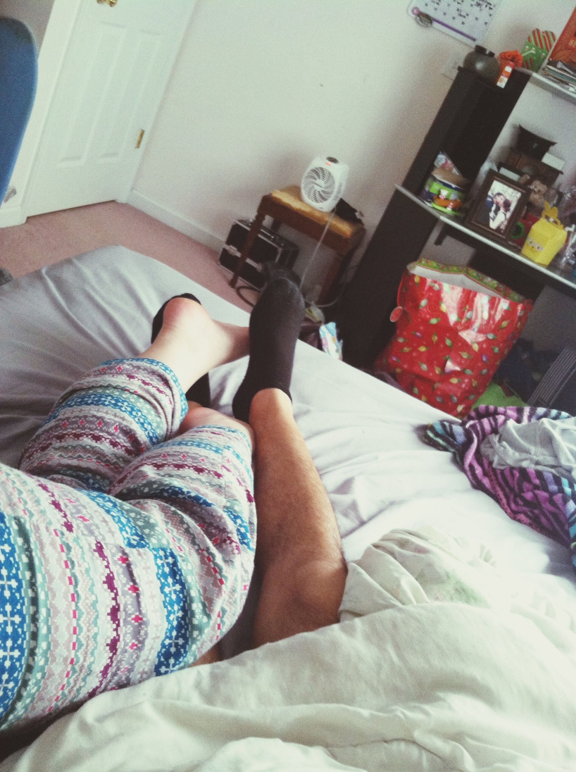 person, indoors, low section, lifestyles, personal perspective, high angle view, human foot, leisure activity, shoe, part of, sitting, jeans, fashion, casual clothing, men