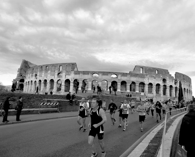 Running in Rome Going The Distance Running Colosseo Sports Photography Cityscape Shades Of Grey People Photography Rome Italy Sport In The City B&w Street Photography Streetphotography