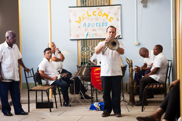 Antique Brass Band Antique Brass Band Classroom Community Cuba Day Education Full Length Indoors  Inside Large Group Of People Learning Men Music Musical Instrument Musician People Real People Sitting Women