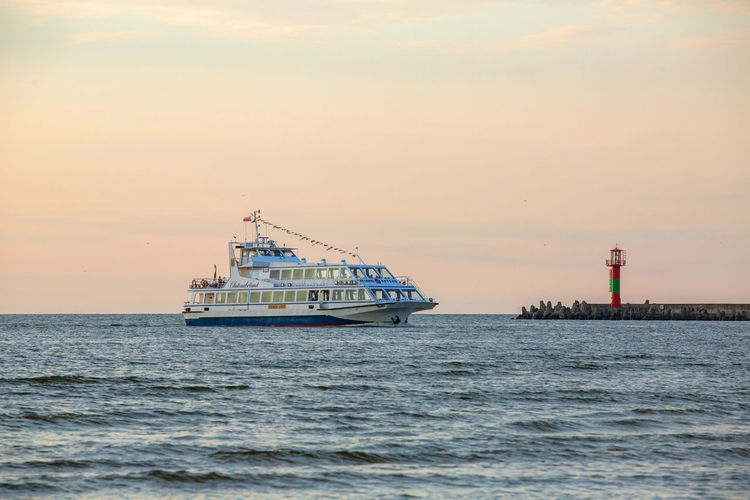 Baltic Sea Beauty In Nature Cloud - Sky Cruise Ship Mode Of Transportation Motion Nature Nautical Vessel No People Outdoors Passenger Craft Rippled Sailing Scenics - Nature Sea Ship Sky Sunset Transportation Travel Water Waterfront