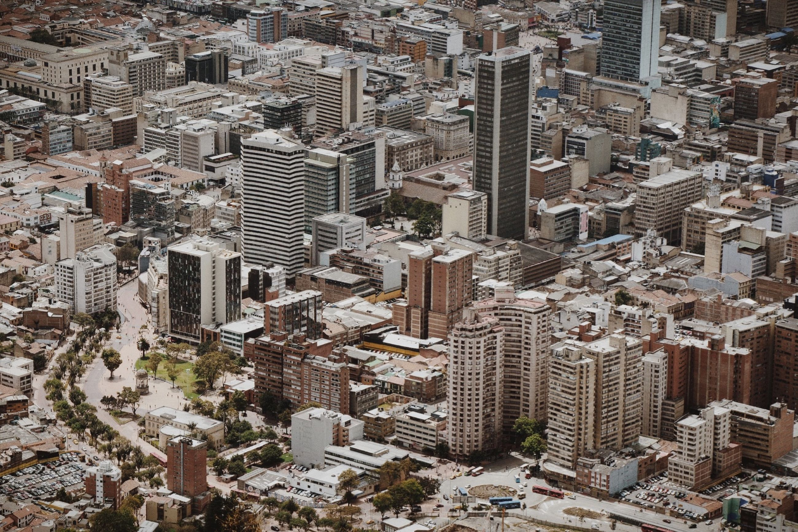 building exterior, architecture, built structure, cityscape, city, crowded, high angle view, skyscraper, residential district, aerial view, residential building, tower, residential structure, outdoors, tall - high, day, modern, no people, office building, city life