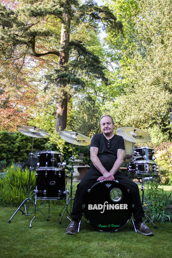 Music to the Soul Badfinger Band Casual Clothing Day Drum Drummer Forest Front View Full Length Grass Green Happiness Lifestyles Looking At Camera Nature Nature One Person Outdoors People Portrait Real People Sitting Smiling Summer Tree