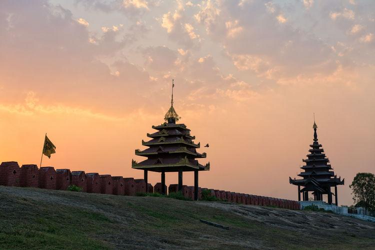 Gazebo in building against sky during sunset