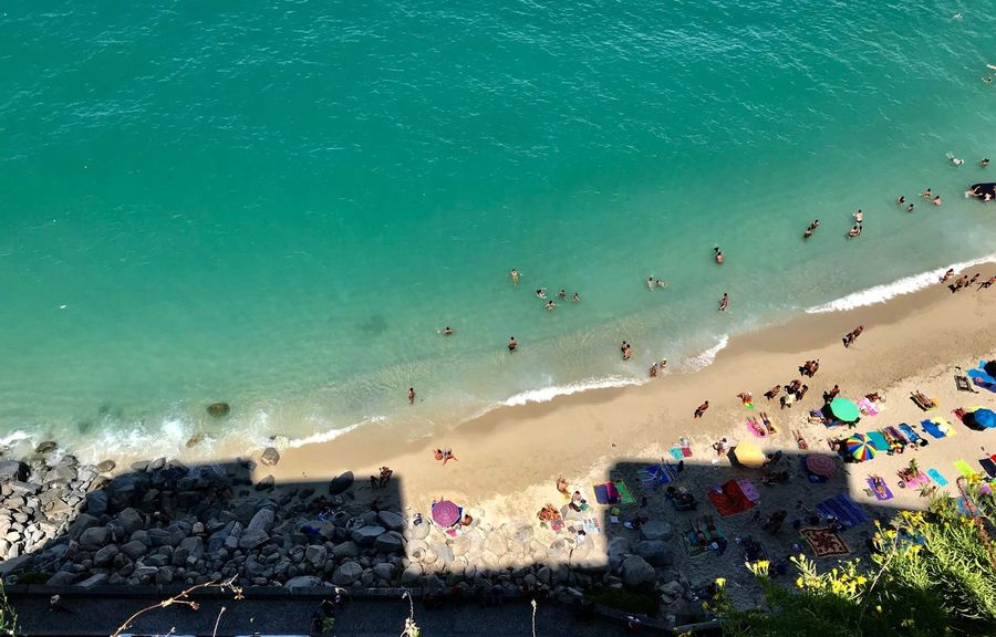 Water Sea Beach Land High Angle View Beauty In Nature Crowd Large Group Of People Sand Group Of People Scenics - Nature Outdoors Wave