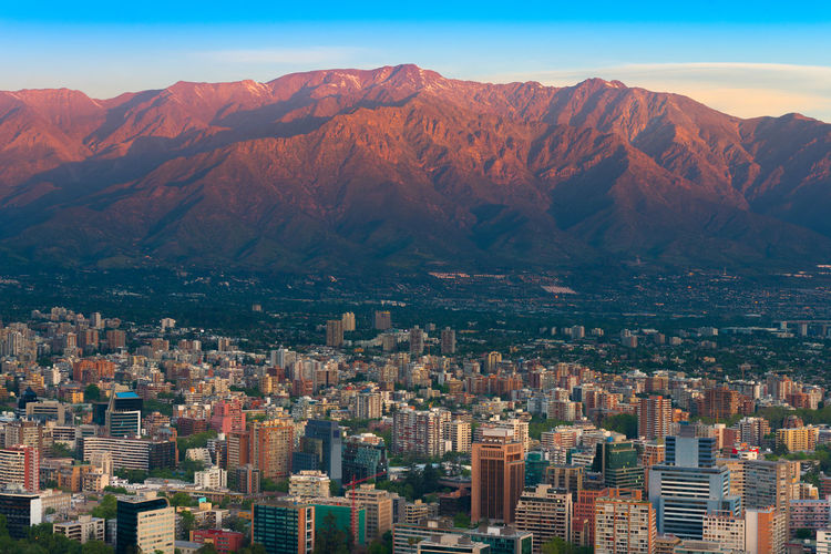 Panoramic view of providencia district with los andes mountain range in santiago de chile