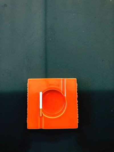 Directly above shot of orange box on wall