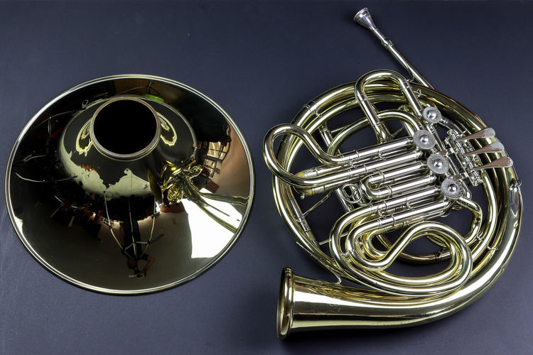 Music Instrument French horn Musical Instrument Music Indoors  Metal Close-up Studio Shot Brass Instrument  Arts Culture And Entertainment No People Still Life Table Directly Above Musical Equipment Brass Wind Instrument High Angle View Gold Colored Colored Background Cut Out Trumpet Silver Colored Blue Background