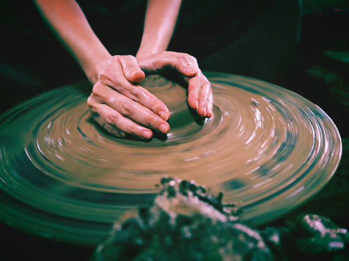 The activity clay pot uses hand workshop mold Ancient Thailand. Crafts Art And Craft Clay Craft Creativity Design Education Finger Hand Human Body Part Human Hand Indoors  Motion Occupation One Person Pottery Real People Selective Focus Skill  Spinning Unrecognizable Person Vintage Water