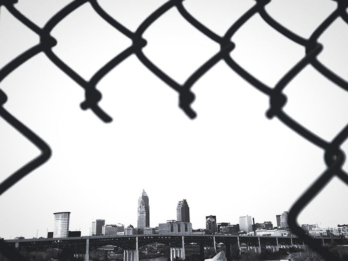 Cleveland skyline framed with cut wire mesh, Ohio, USA. Black and white shot. Copy Space In Sky Skyscrapers Skyline Frame Chainlink Fence Mesh Wire Fence United States Of America Ohio, USA Cleveland Black And White Architecture Built Structure Chainlink Fence Fence Building Exterior Sky City Barrier No People Cityscape Outdoors Travel Destinations