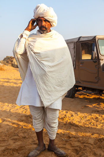 Cellular Device Day Desert Full Length India Indian Man Jeep Rajasthan Sunlight Tradtional Rajasthan Clothe Turban White Clothes India