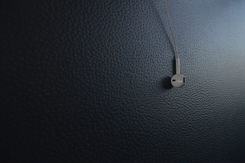 High angle view of headphones on leather seat