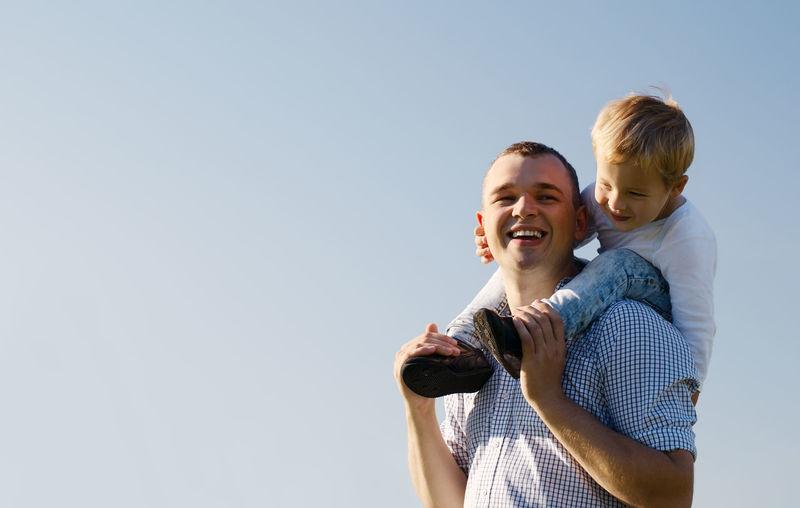 Blue Sky Boy Caucasian Copy Space Enjoying Family Father Joy Male Man Outdoors Parent Park People Piggy Back Piggyback Shoulders Son