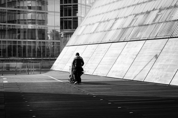 Cleaning Up Built Structure Architecture Building Exterior One Person Walking City Day Building Office Building Exterior Modern Direction Monochrome Blackandwhite Black And White Black & White Urban Urban Geometry Candid Working Man Düsseldorf Germany German Deutschland Canon