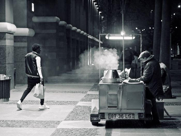 City Real People Street Transportation Full Length Architecture Night Men Mode Of Transportation Casual Clothing Illuminated People Road Land Vehicle Motion Incidental People Built Structure Building Exterior Walking City Life Social Issues The Art Of Street Photography