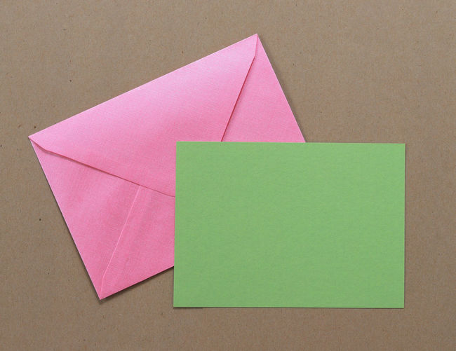 Close-up of paper and envelop over table