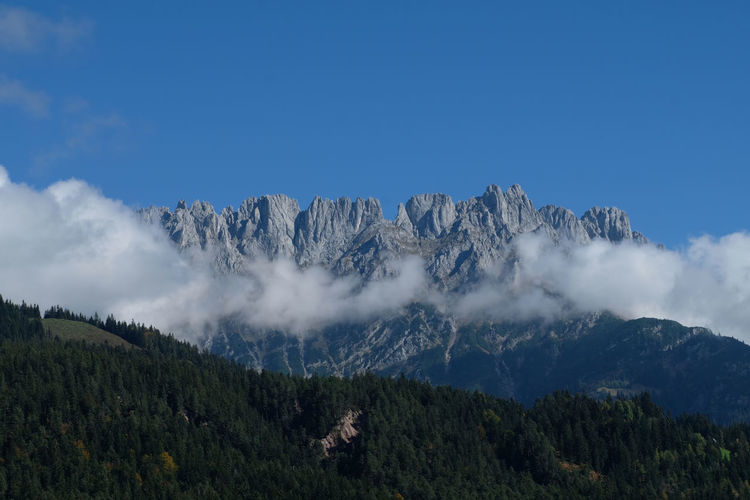 Kaisermountain breathtaking scenery with blue sky, liw hanging white clouds  alpine peaks and valley