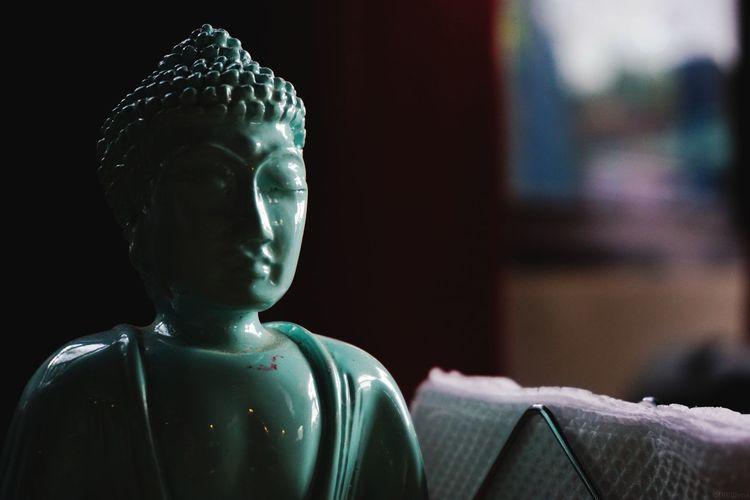 Close-Up Of Buddha Statue In Darkroom