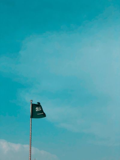 saudi Sky Low Angle View Nature Blue No People Cloud - Sky Day Floodlight Sunny Beauty In Nature Sign Communication Patriotism Copy Space Lighting Equipment Outdoors Pole Flag Tranquility Street Light