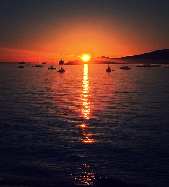 Summer sunset at Kitsilano Beach, Vancouver BC Beauty In Nature Boat Kitsilano Landscape Landscape_Collection Landscape_photography Mountainscape Nature No People Ocean Orange Color Orange Sunset Sailboats Summer Sun Sun Sunset Sunset Over Water Sunset_collection Water Water_collection Waterfront Yatch
