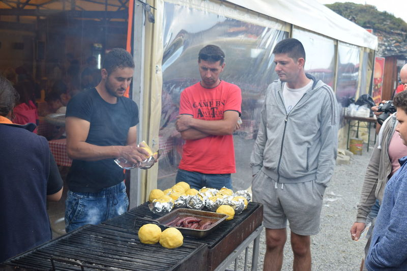 Barbecue Casual Clothing Food Food And Drink Freshness Friends Friendship Front View Grilling Group Of People Holding Leisure Activity Lifestyles Looking Mamaliga Mode Of Transport Outdoors Person Romania Romanian Food Standing Together Togetherness Transfagaraşan Transportation