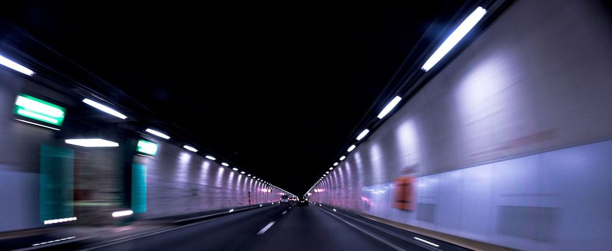 Highway tunnel Inside The Mountain Modern Dark Road Fast Speed Illuminated Transportation The Way Forward Direction Lighting Equipment Road Architecture Tunnel Diminishing Perspective Light Empty Built Structure Electric Light