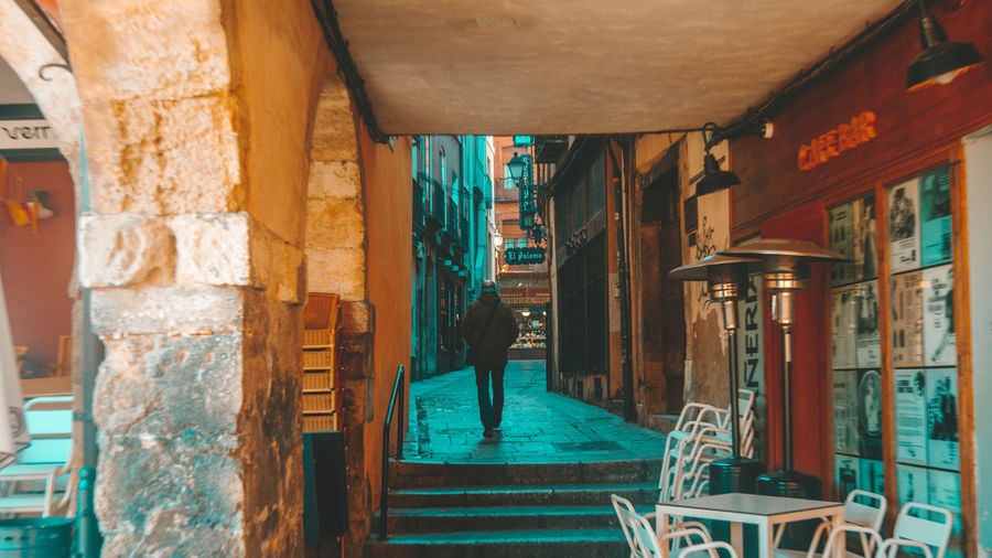 Architecture Built Structure One Person Real People Full Length Building Exterior Lifestyles Day Men Building Leisure Activity Rear View Standing Walking Outdoors Sunlight Casual Clothing City Architectural Column Alley