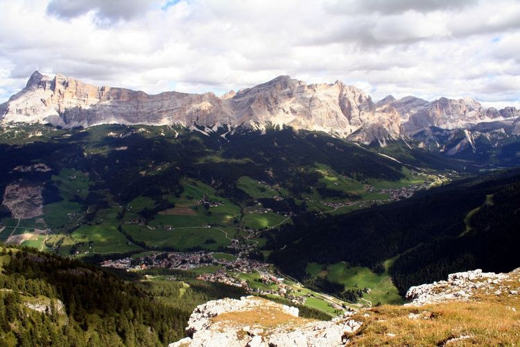 Scenic View Of Dolomites Mountain Range Against Cloudy Sky