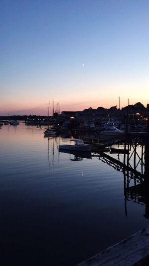 Boothbay Harbor Water Nautical Vessel Reflection Sunset Tranquil Scene Moored Tranquility Beauty In Nature Nature Outdoors Transportation Scenics No People Sky Clear Sky Sea Harbor Mode Of Transport Travel Destinations Sailboat Harbor Harbour Boothbay Harbor Maine Maine