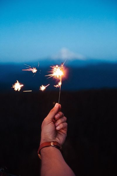 EyeEm Selects Human Hand Burning Firework - Man Made Object Sparkler Celebration Sparks Human Body Part Holding Long Exposure Real People Night Flame Firework Display Glowing One Person Personal Perspective Exploding Motion Illuminated Human Finger Fresh On Market 2017