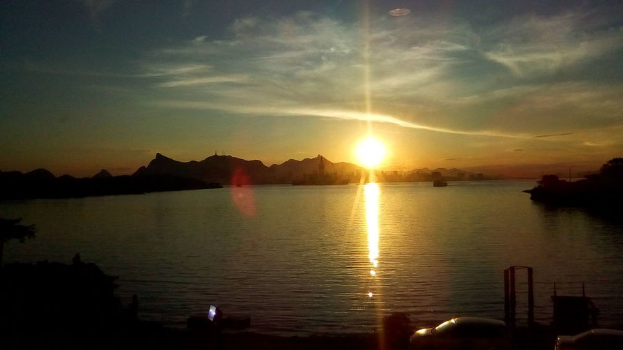 Sunset Reflection Water Sky Silhouette Sun Scenics Nature Beauty In Nature Tranquil Scene Tranquility Lake Outdoors Sunlight Cloud - Sky No People Awe Star - Space