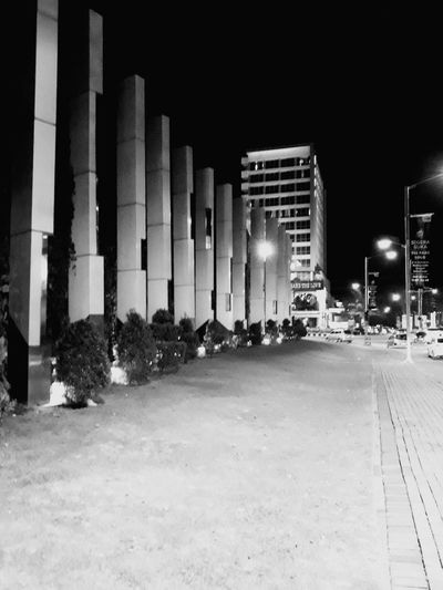 Streetphotography Blackandwhite Black And White Bw Bw_collection City Illuminated Architecture Building Exterior Built Structure Sky Architectural Column Underneath Arcade The Past Pediment Ancient Rome Historic Building Archaeology Arch City Gate Column Historic Civilization Passage Amphitheater Passageway Colonnade Ancient Civilization Old Ruin