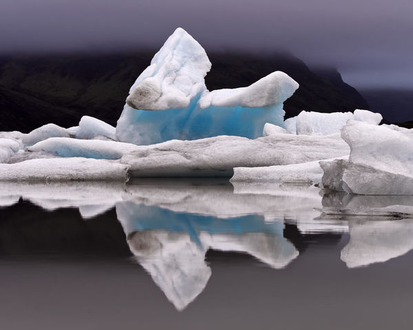 Iceland Beauty In Nature Blue Ice Blue Ice Glacier Cold Temperature Frozen Glacial Glacier Glacier Lagoon Ice Iceberg Iceland Trip Lake Nature No People Outdoors Reflection Scenics Sky Tranquil Scene Tranquility Water Waterfront Winter Perspectives On Nature