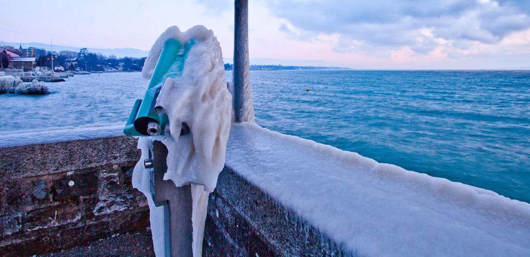 Calm Blue Sea Against Sky During Winter