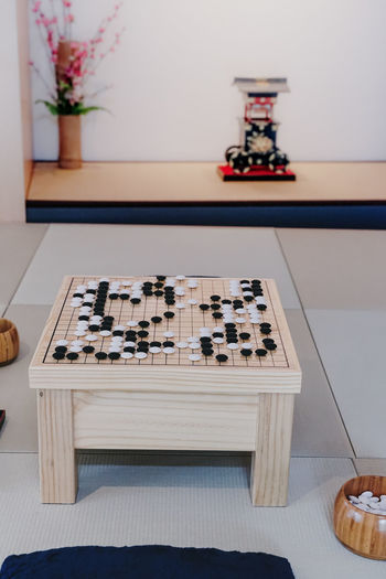 Low angle view of chess board on table at home