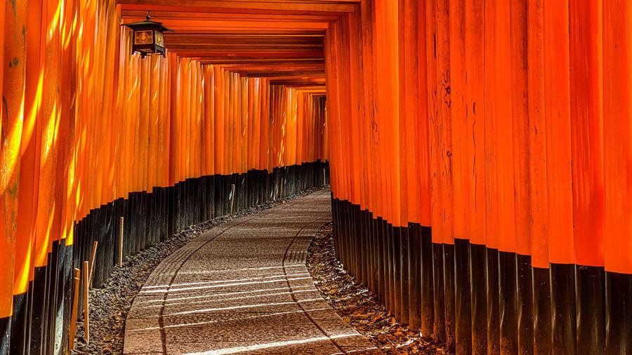 Corridor of building against orange sky
