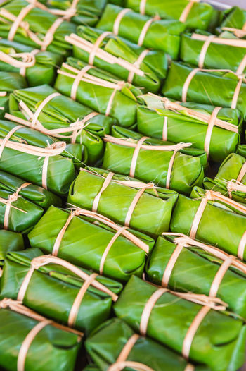 Full Frame Shot Of Food Wrapped In Banana Leaves At Market