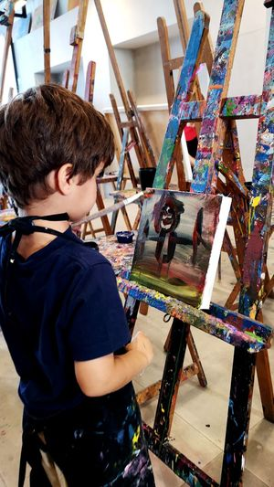 Boy painting artist canvas