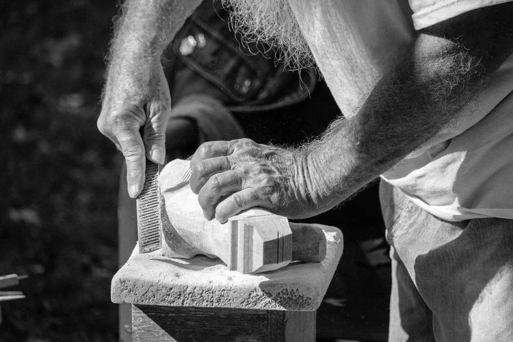 Skilled Hands Black & White Skill  Adult Art Black And White Blackandwhite Close-up Craft Day Holding Human Hand Manual Worker Men Occupation One Person Outdoors People Real People Sculpture Skill  Work Tool Working