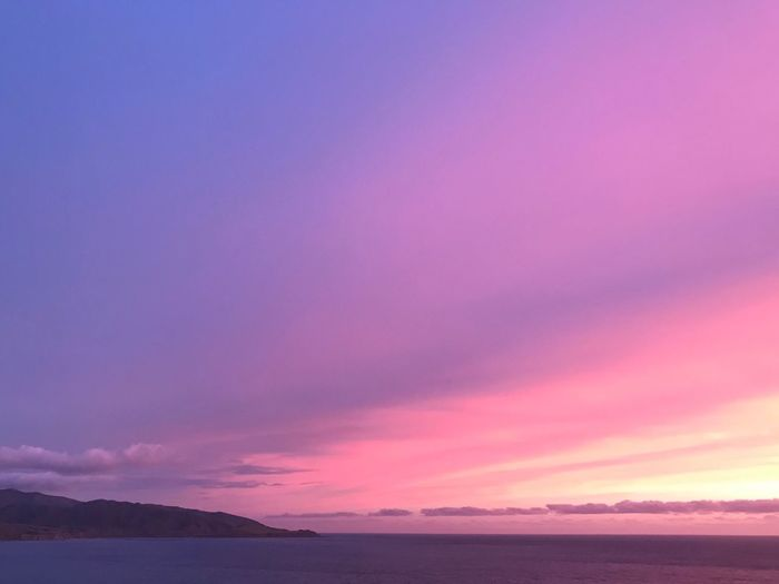 Beauty In Nature Water Pink Color Sky Scenics - Nature Sea Sunset Purple Tranquil Scene Cloud - Sky Tranquility No People Nature Horizon Horizon Over Water Magenta Outdoors Multi Colored Dramatic Sky Idyllic