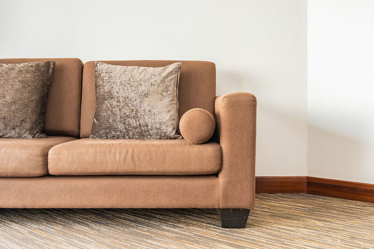 Sofa on table against wall at home