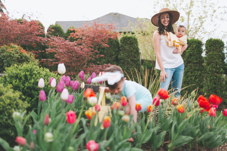 Smiling woman with children in garden