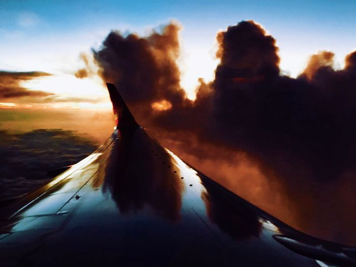 Flying Into The Dusk Sky Transportation No People Sunset Mode Of Transport Cloud - Sky Airplane Outdoors Air Vehicle Low Angle View Close-up Day Nature Airplane Wing BEIJING北京CHINA中国BEAUTY IPhone Photography City Travel Destinations Urban Skyline